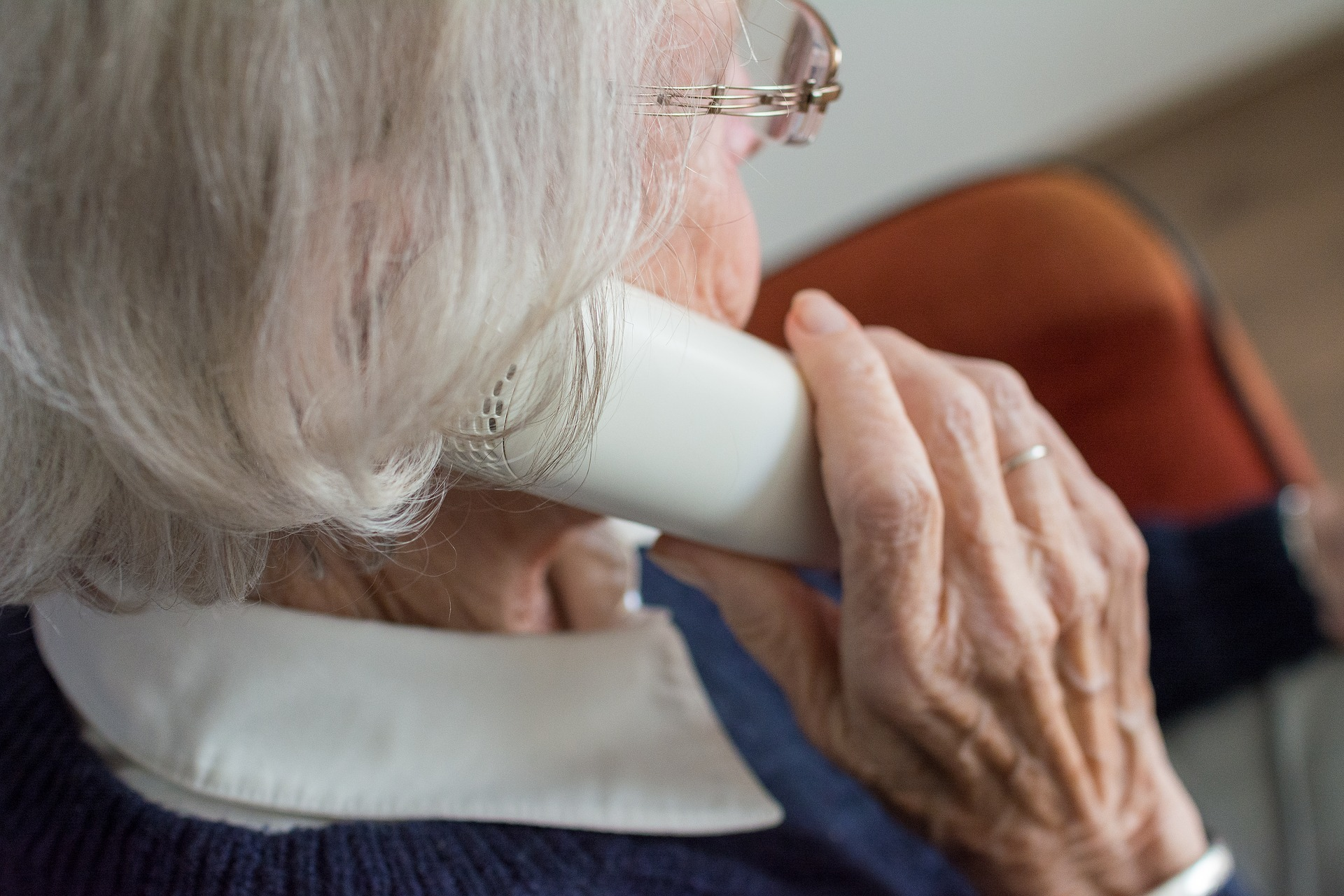 Elderly woman on the phone.