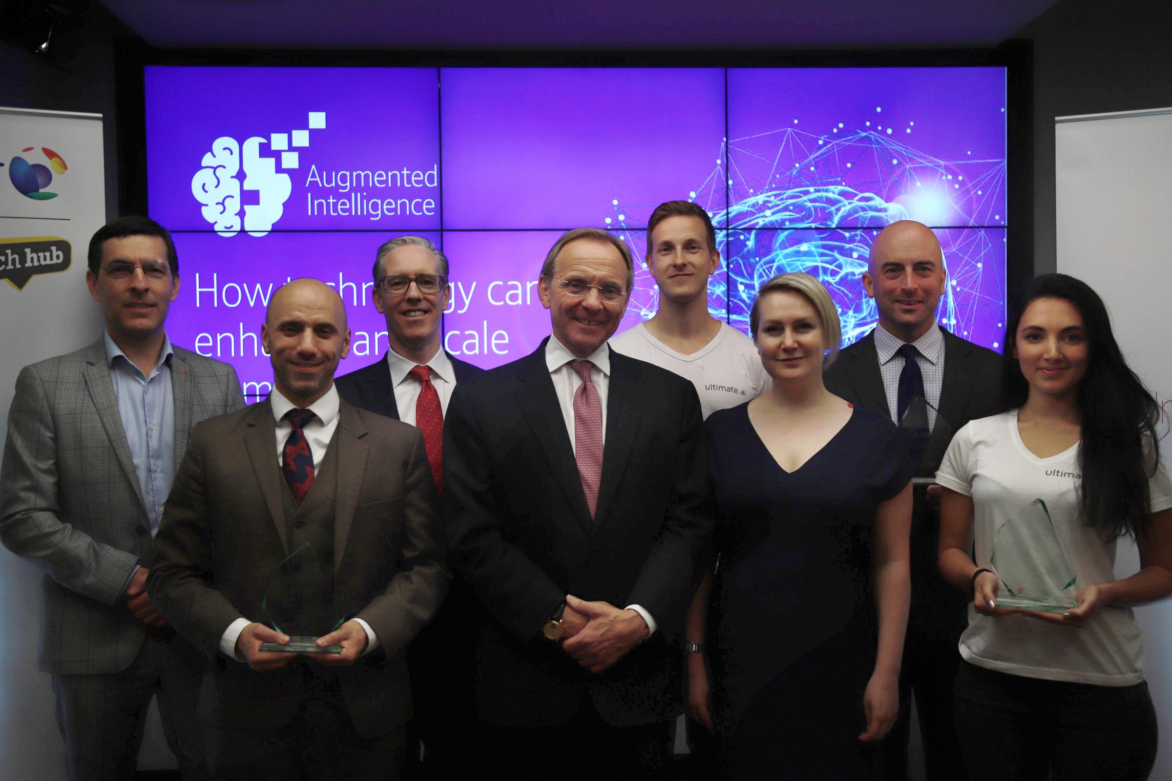 Pictured left to right: Simon Godfrey of BT, Dan Sola of Archangel, Colm O'Neill of BT, John Manzoni of the Cabinet Office, Reetu Kainulainen of ultimate.ai, Elizabeth Varley of TechHub, Alastair Harvey of Cortexica and Sarah Al-Hussaini of ultimate