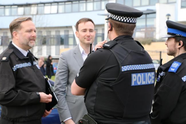 Oxford city commander Joe Kidman with Tom Hayes and other officers