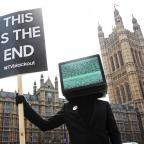 Oxford Mail: 'TV heads' with signs calling for the end of blank TV screens to promote a new advertising campaign (Joe Pepler/PinPep)