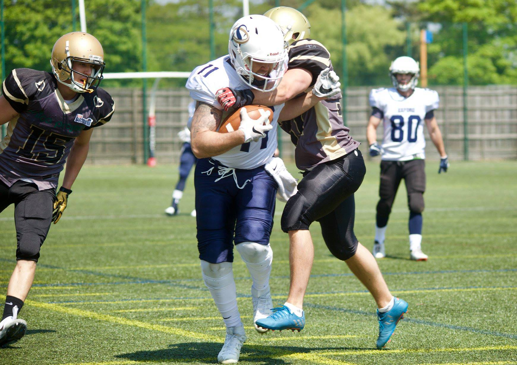 STRONG RUN: Oxford Saints' wide receiver Jason Williams takes some stopping                        Pictures: Jamie Stancombe