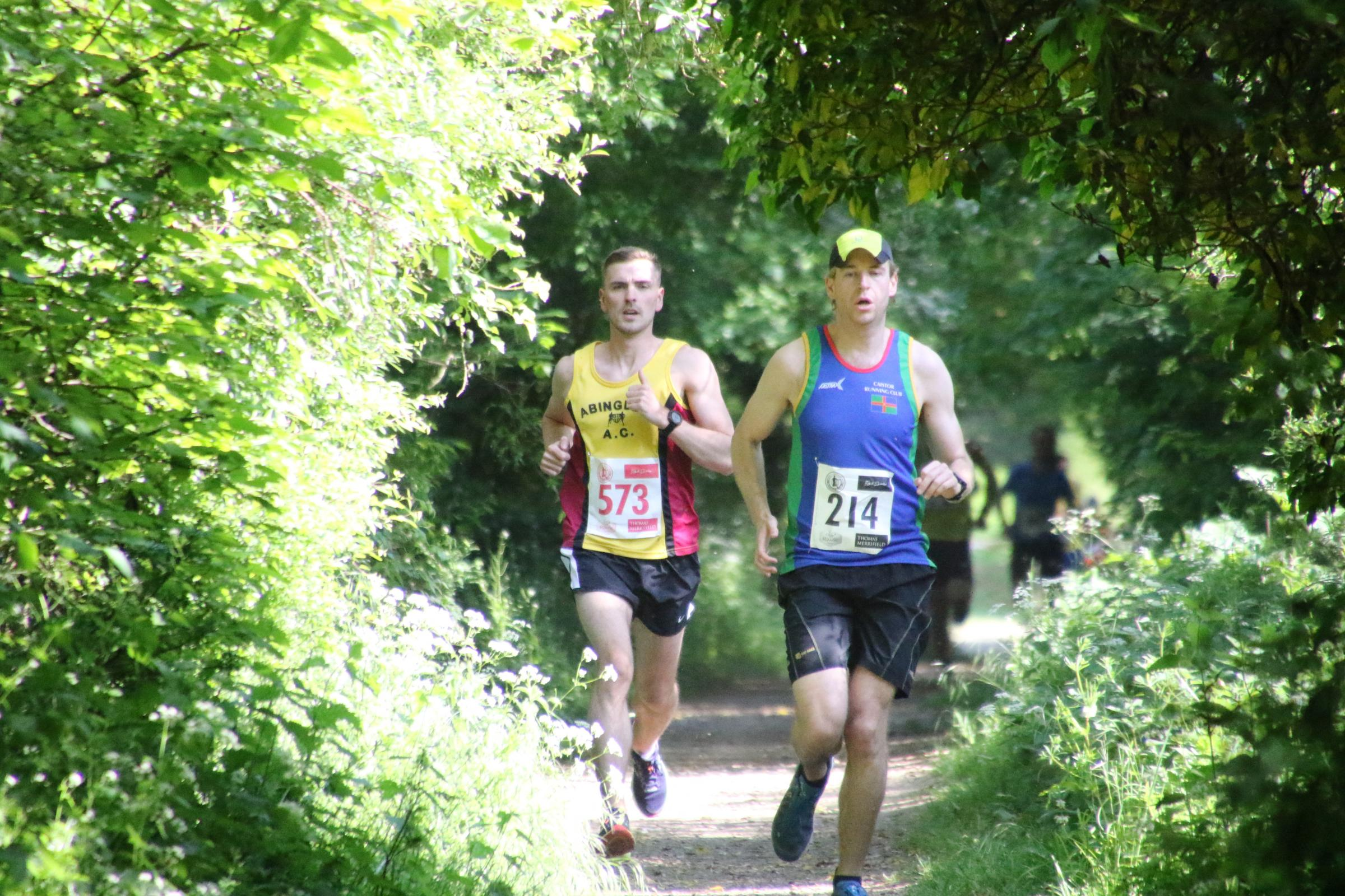DIGGING DEEP: Harrison Read, pictured with the 10k winner Rob Payne, looks comfortable during the Thames Run 5kPicture: Barry Cornelius