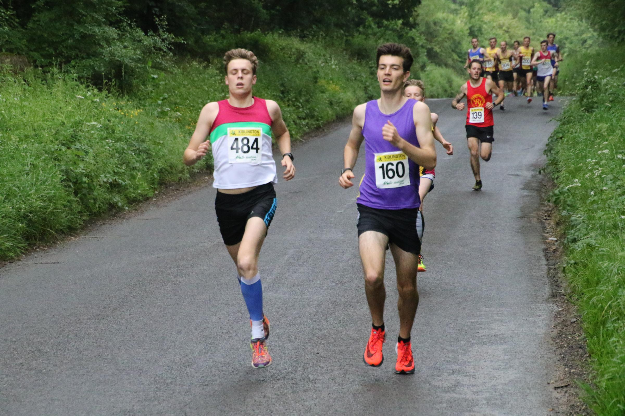 HEAD-TO-HEAD: Radley's Alex Miell-Ingram (160) just leads Gregor Kelling (Banbury) in the Mota-vation Series race at Bletchingdon before storming clear                              Picture: Barry Cornelius