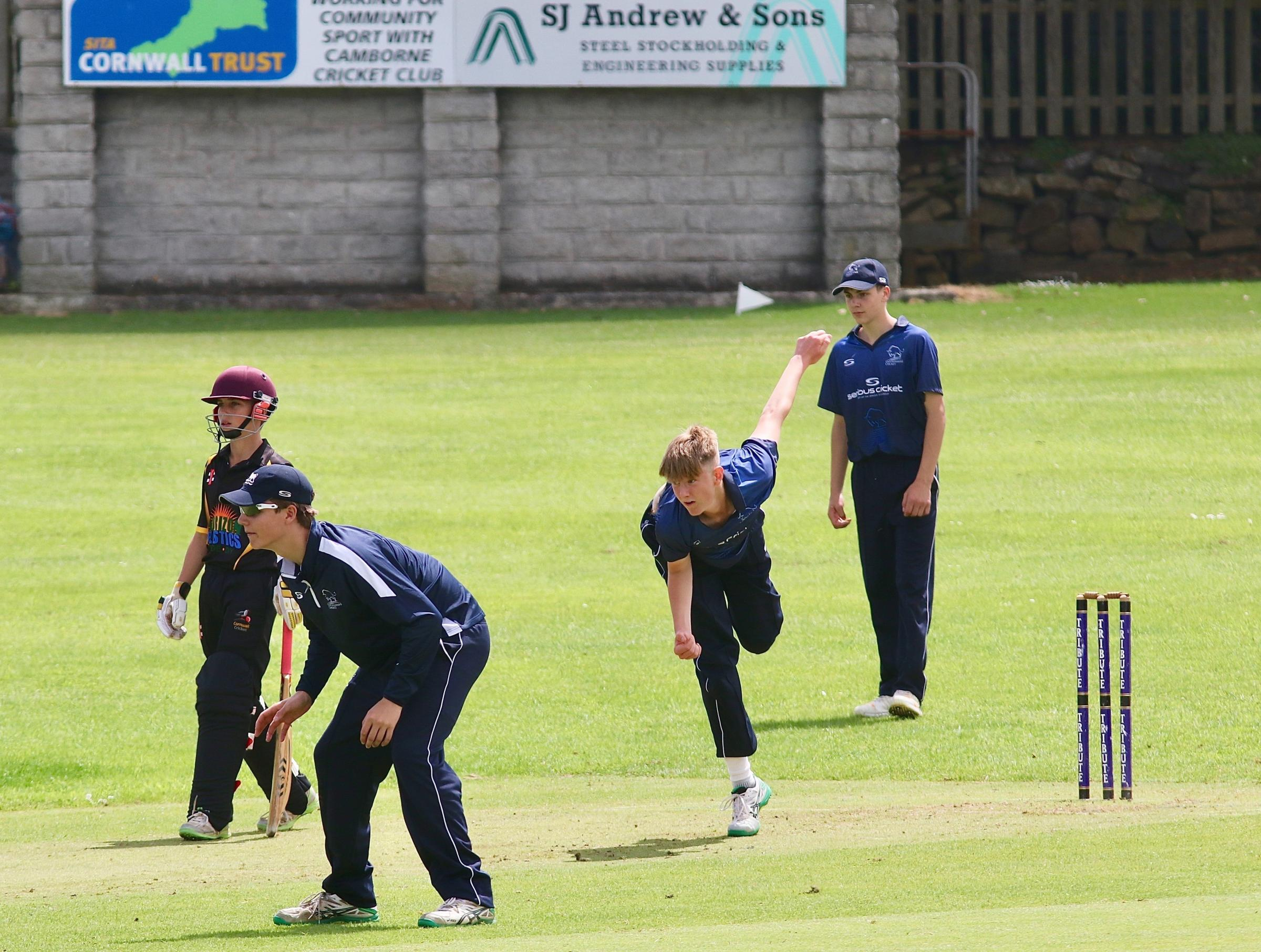 WHAT A HAUL: Tom Lydford-Brace in full flight during his spell of 5-2 for Oxfordshire Under 15s away to Cornwall at Camborne CC