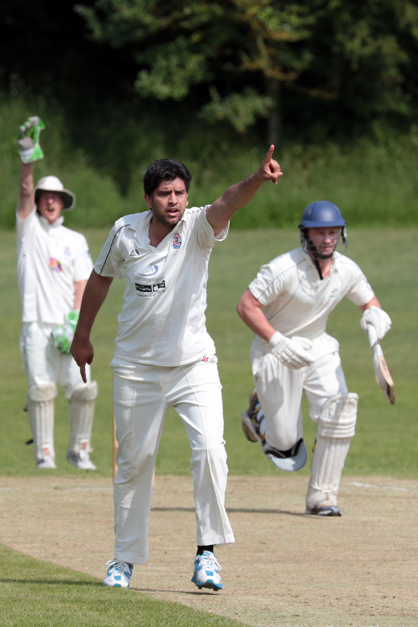 Radley bowler Uddin Naeem and wicket-keeper Peter Davenport appeal for lbw against Combe's Mark Francis in their Division 4 clashPictures: Ric Mellis