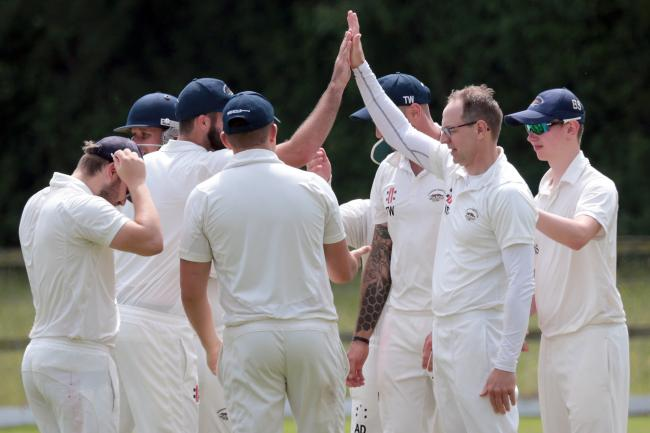 SUPER SHOW: Neil Smith (right) gets a high five after trapping Max Mannering lbw  Pictures: Ric Mellis