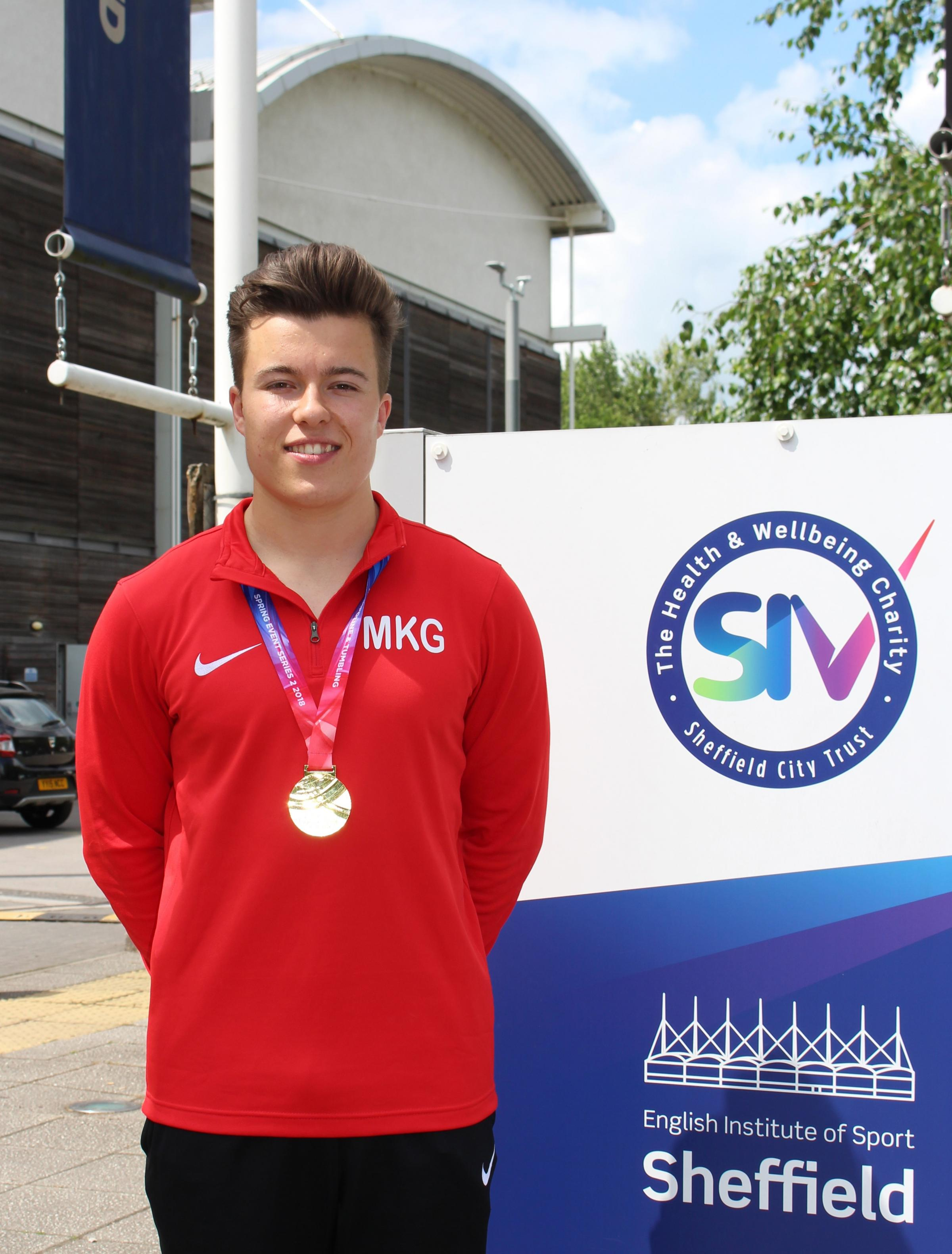 TRIUMPHANT DISPLAY: Ben Goodall proudly displays his gold medal at Sheffield