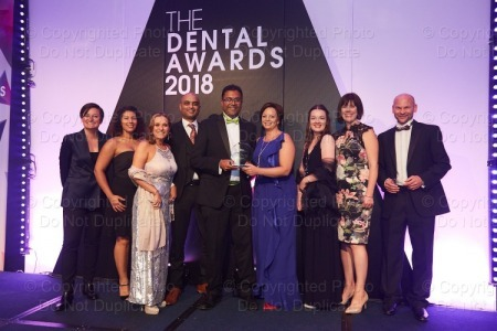 The team from Imogen Dental in Benson picking up their award for Dental Practice Team of the Year 2018 in the South of England. Picture: Purple Media