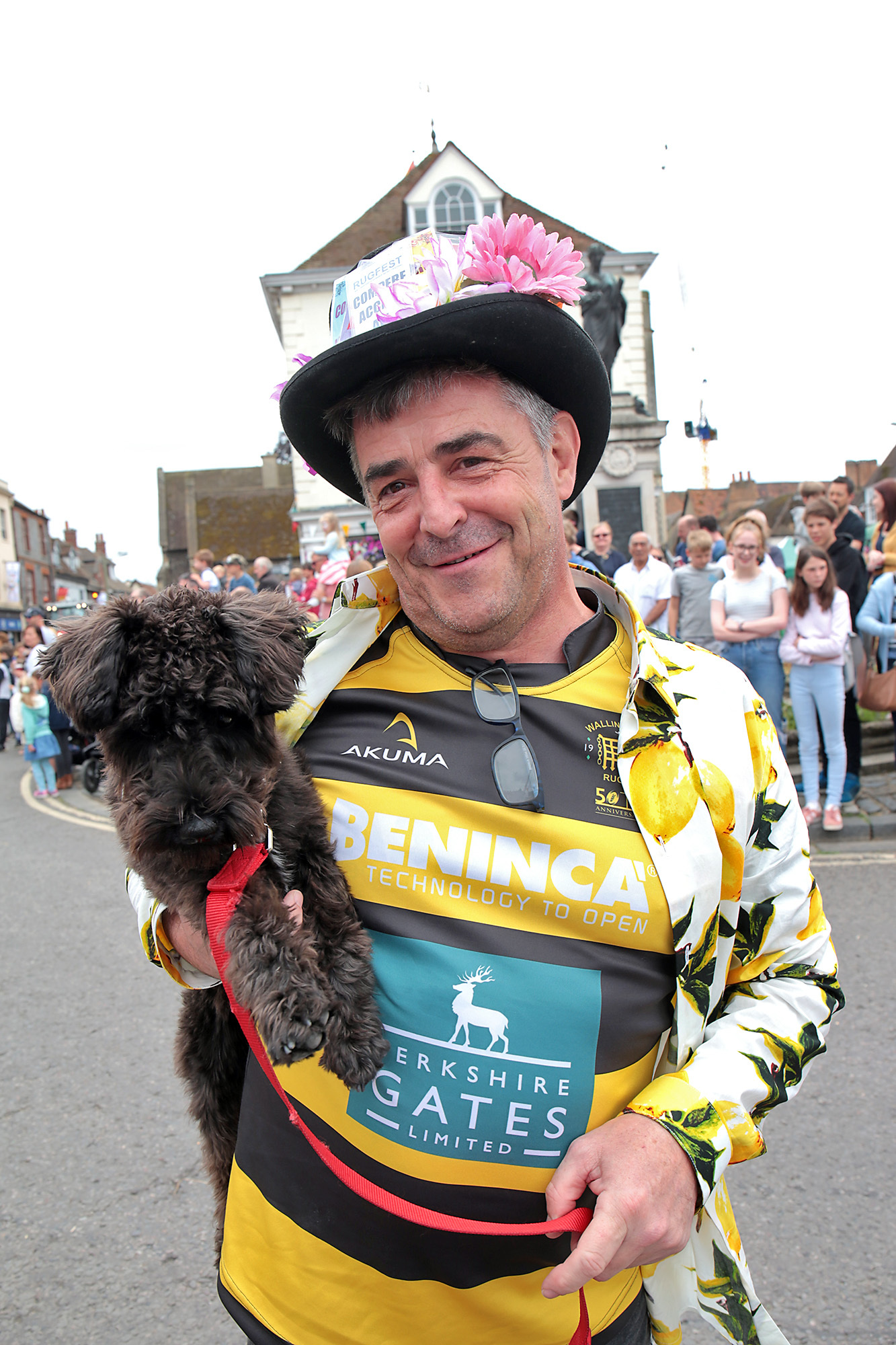 FLUFFY: Guy Hewitt, organiser of Rugfest, with mini Schnauser Bella at the parade. Picture: Ric Mellis