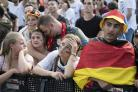 Disappointed Germany fans react after the side was eliminated from the World Cup
