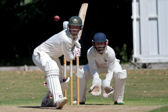 IN THE RUNS: Shipton's century-maker Charlie Miller drives confidently during their victory over Great Tew Picture: Ric Mellis