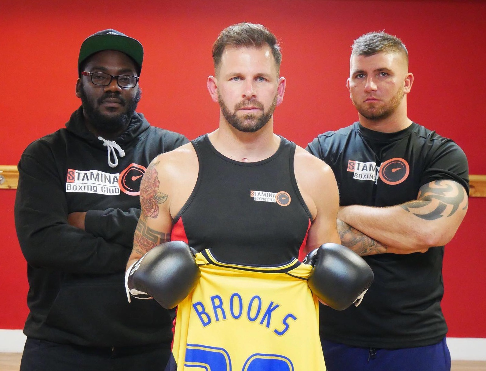 TOUGH CHALLENGE: Former Oxford United striker Jamie Brooks with Adrian Prescott (left) and Kieran Davis from the Stamina Boxing Club, who are helping him ahead of his one-off fight