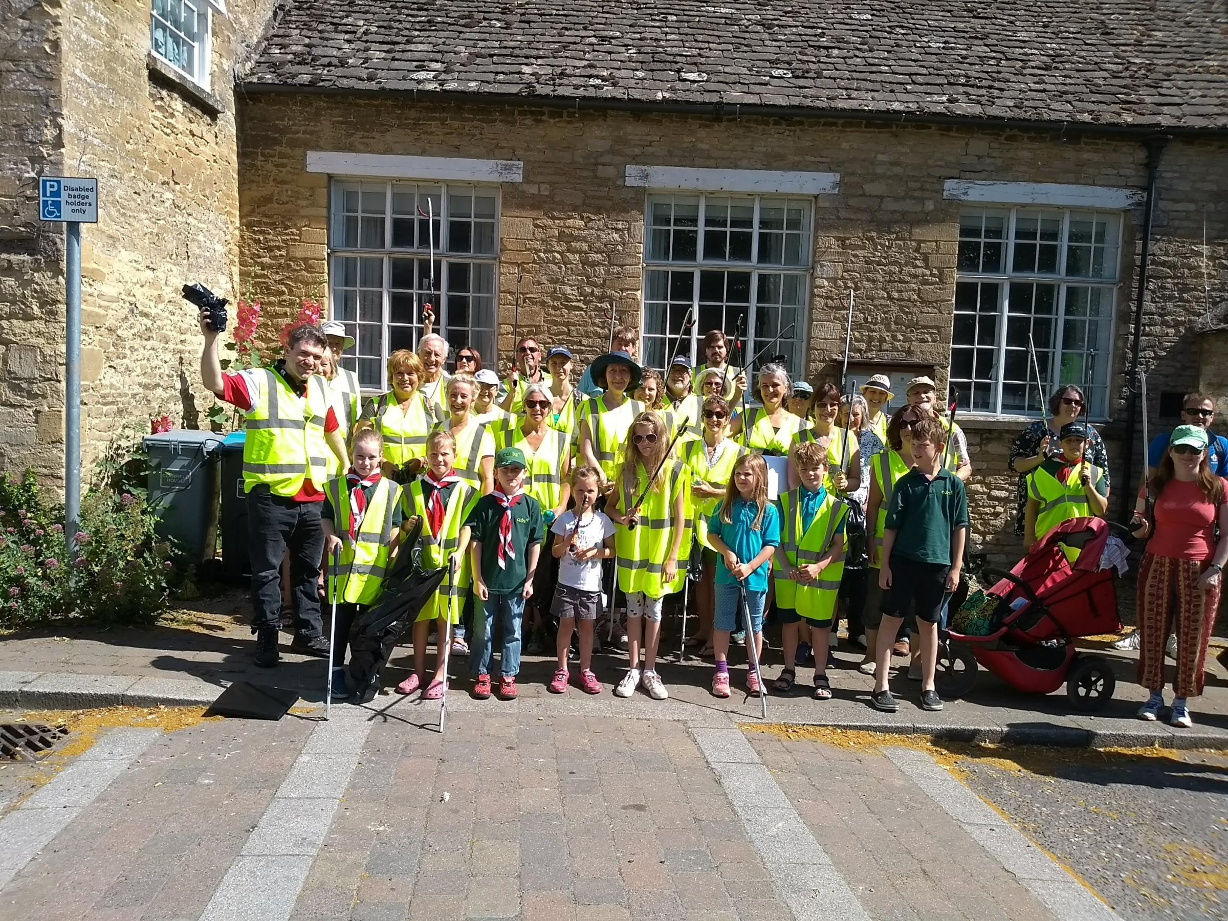 West Oxfordshire District Council leader James Mills, far left, helped almost 40 people clean up Bampton Picture: Maurizio Fantato
