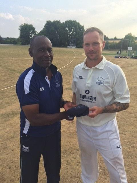 FINE DISPLAY: Gareth Andrew, who finished with match figures of 14-107 against Dorset, receives his county cap from Oxfordshire head coach Rupert Evans Picture: Nick Pinhol