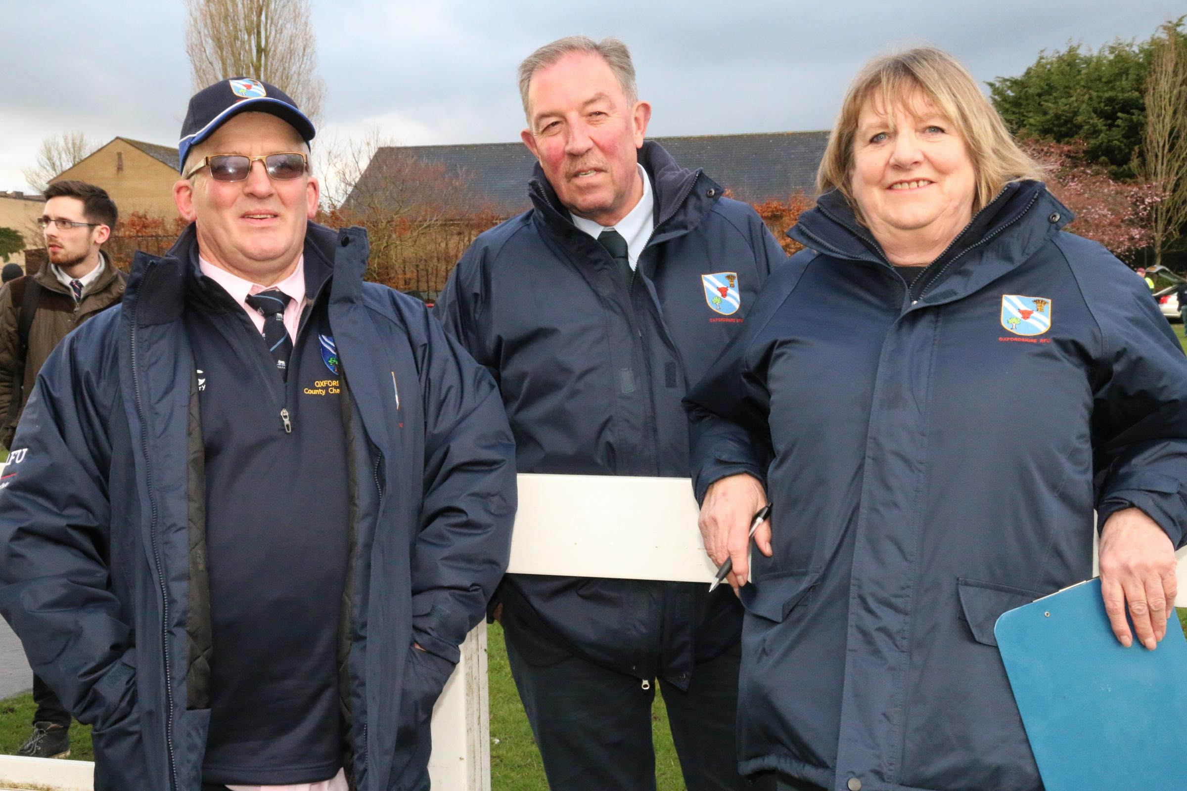 HONOUR: Oxfordshire RFU's new president Jenny Bosley (right) with husband and chair of representative rugby Doug Bosley (left) and outgoing president Rob Walsh Picture: Simon Grieve