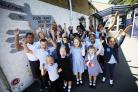 Pupils celebrate at John Henry Newman Academy in Littlemore, with headteacher Katie Screaton (back). Pic by Ed Nix