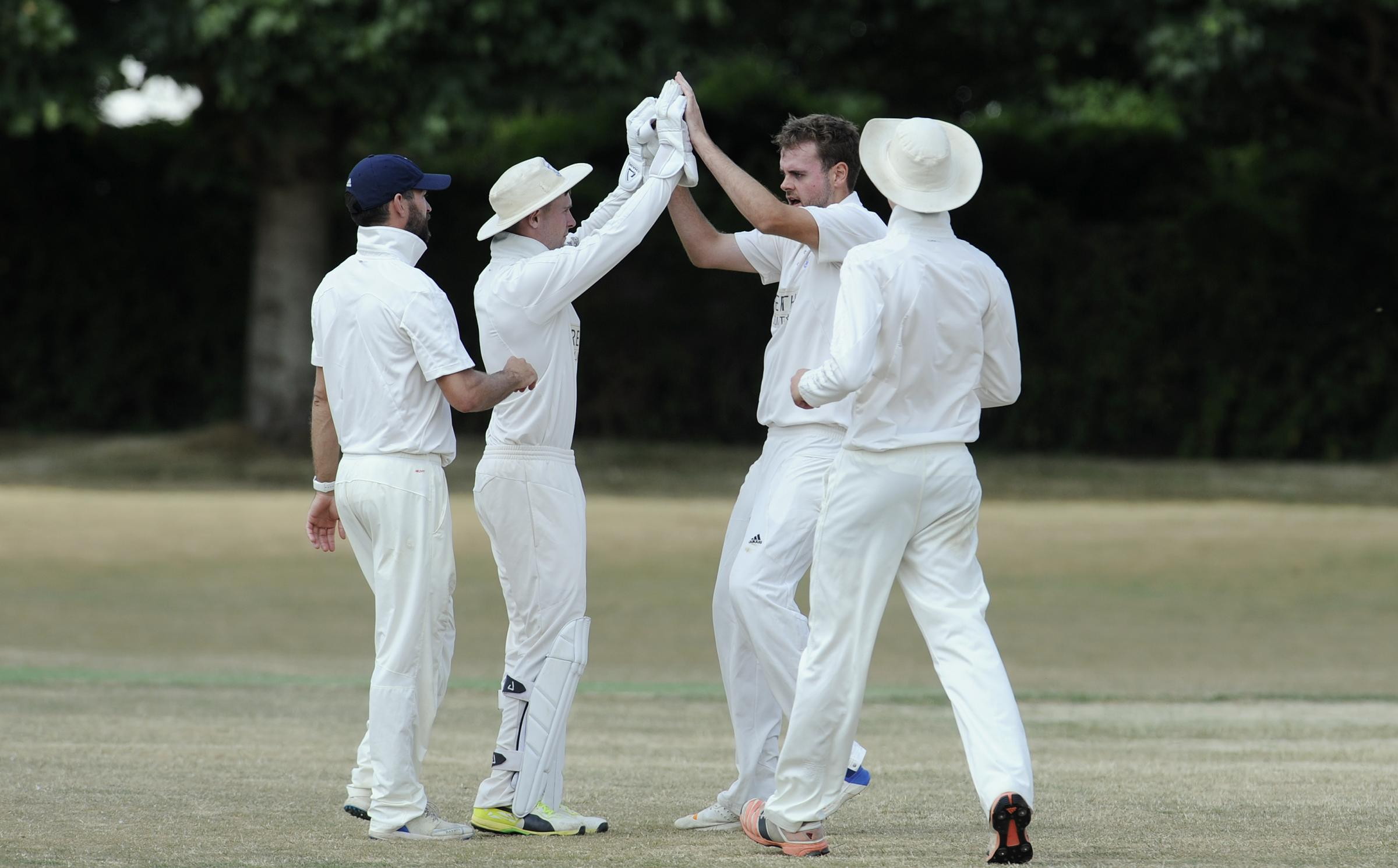 EARLY WICKET: Oxford bowler Rob Keat celebrates with Calvin Dickinson after Horspath opener Tom Coleman edged his delivery to the wicket-keeper as the side's played out a draw in Division 1 Picture: David Fleming