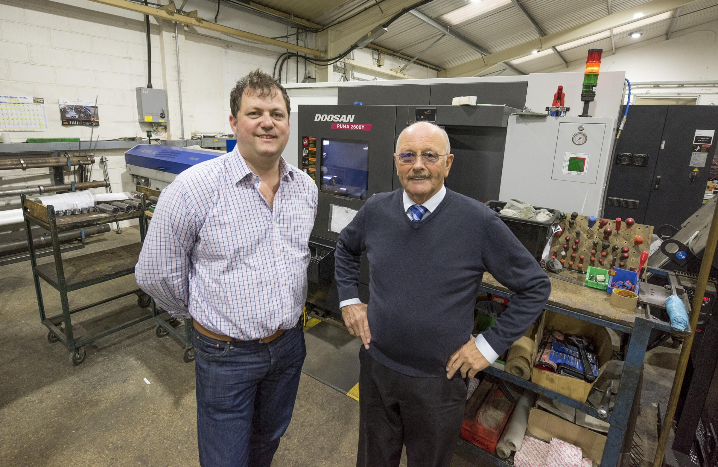 FAMILY AFFAIR: Jason Hydraulics managing director Conrad Edwards, left, with father and company chairman Fred Edwards, who founded the company in 1968 Picture: Christina Morris