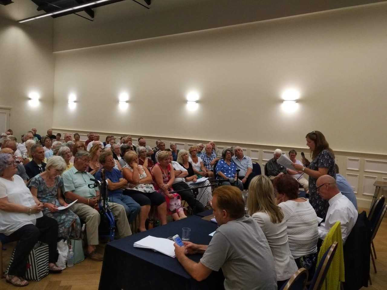 District councillor Rosa Bolger, standing, speaks at last week's Cogges Surgery meeting. She is part of a cross-party group to support patients Picture: Rosa Bolger