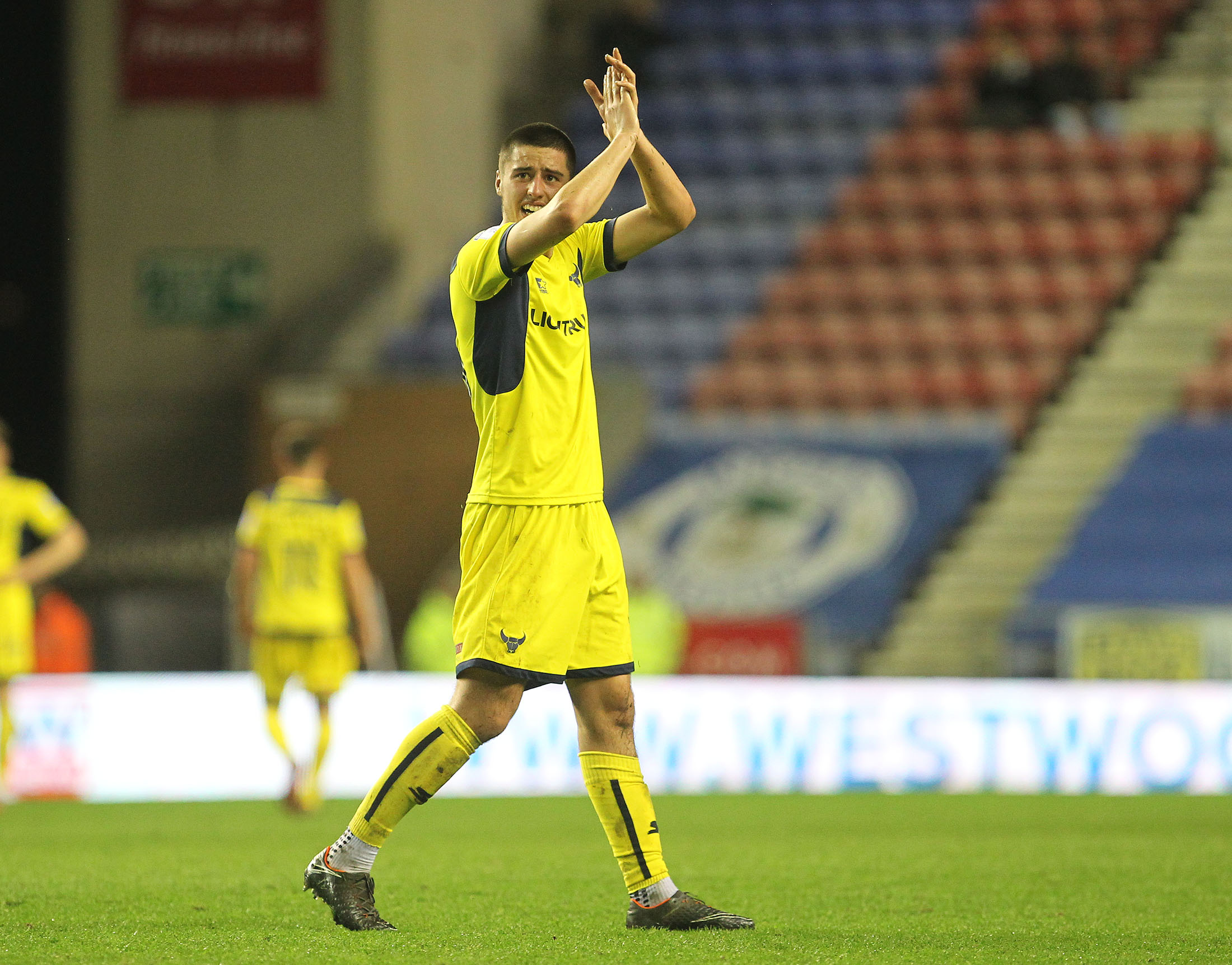Canice Carroll applauds the United fans at Wigan last season - his final appearance for Oxford United Picture: Richard Parkes