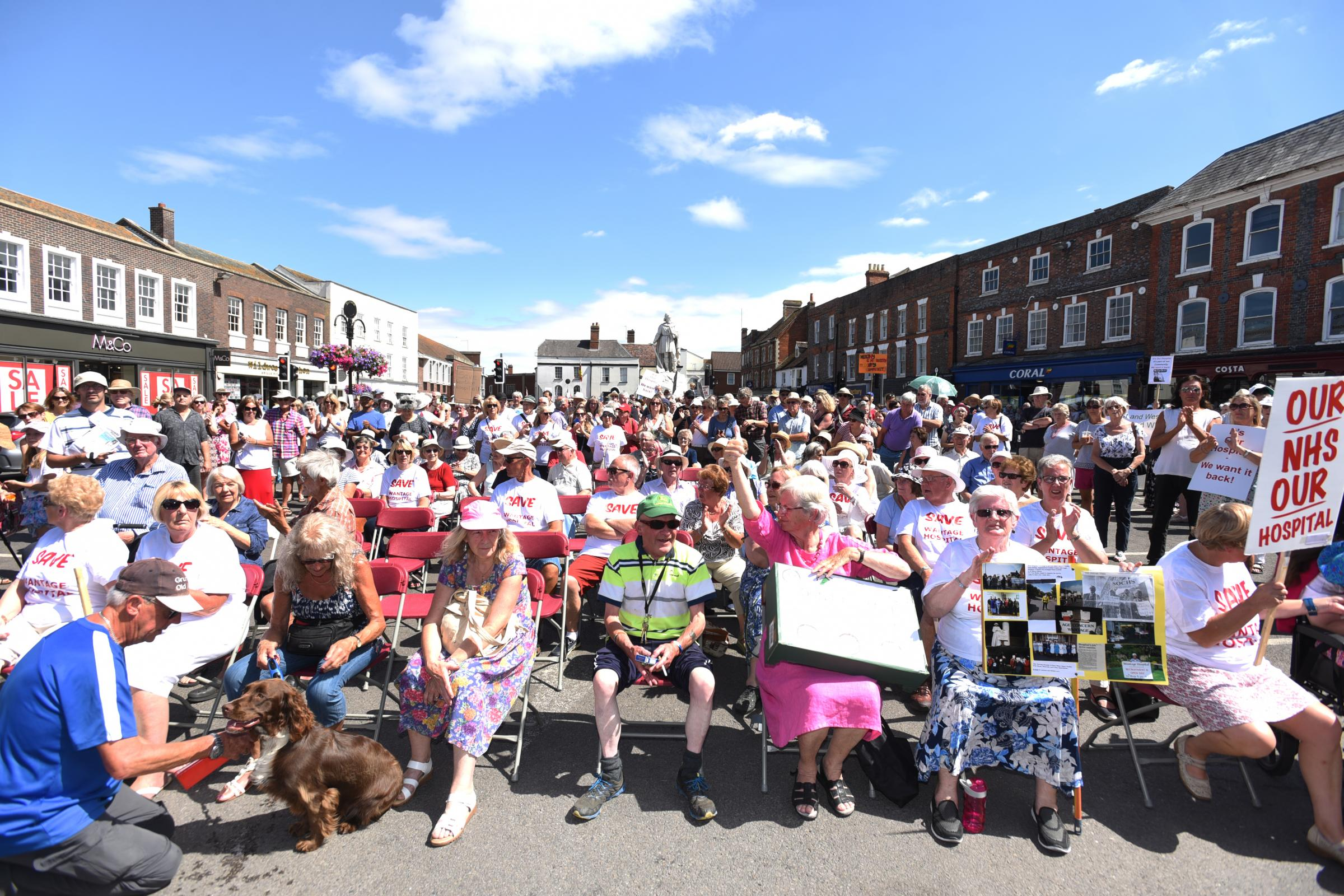 MARCHING: Residents from across Wantage and Grove marched through the town and Rally at market square to protest the 'temporary' closure of the community hospital. Picture: Richard Cave