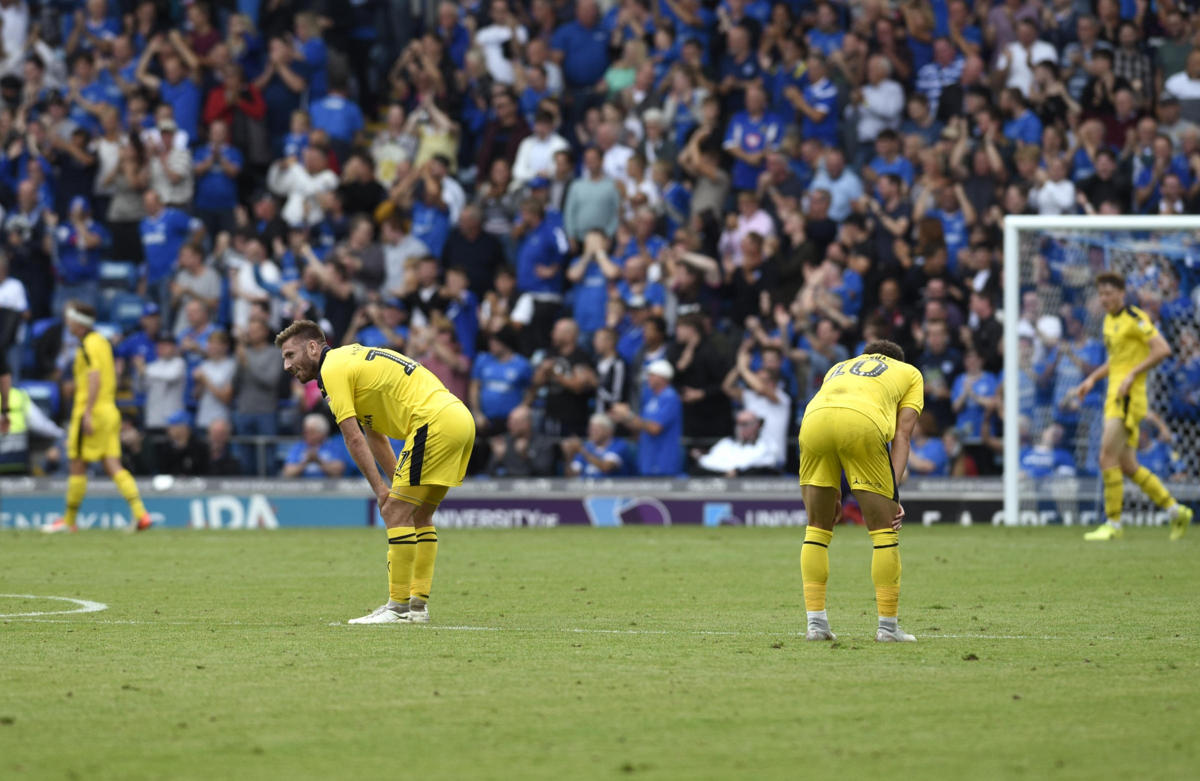DOWN IN THE DUMPS: James Henry and Marcus Browne after Portsmouth score their fourth goal Picture: David Fleming