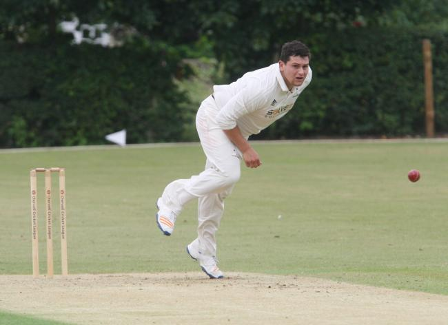 IN THE WICKETS: Tom Costley took 5-38 as Oxford Downs moved just one victory away from the Division 1 title
