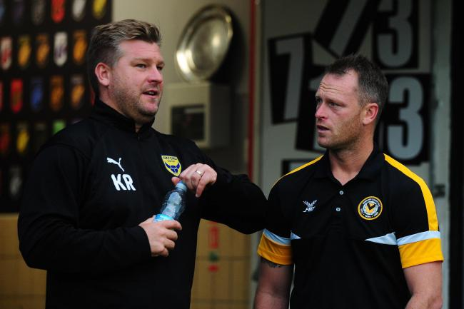 IN CONVERSATION: Karl Robinson (left) talks with Newport boss Michael Flynn before the midweek game 	        Picture: Tom Sandberg/PPAUK