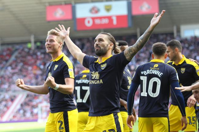 Ricky Holmes salutes the Oxford United travelling support after opening the scoring against Sunderland  Picture: Richard Parkes