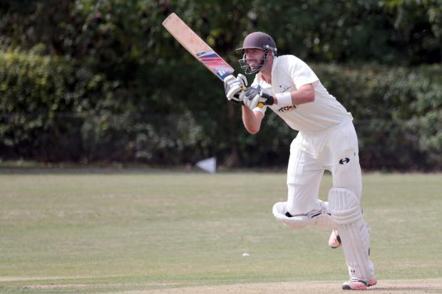 Chris Sandbach hits out during his century which helped Oxford Downs to secure the Cherwell League title with a convincing victory over Twyford  Picture: Ric Mellis