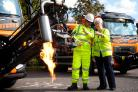 Tim Harris shows the new Dragon Patcher machine to Yvonne Constance, cabinet member for the environment. The machine is now being used to repair potholes on the county's roads. Picture: Ric Mellis