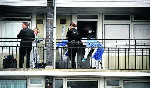 CRIME SCENE: Police and forensic officers at the Friars Wharf flat in 2012