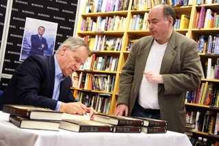 Jeffrey Archer signs a copy of his new book for Stephen Smith from Witney