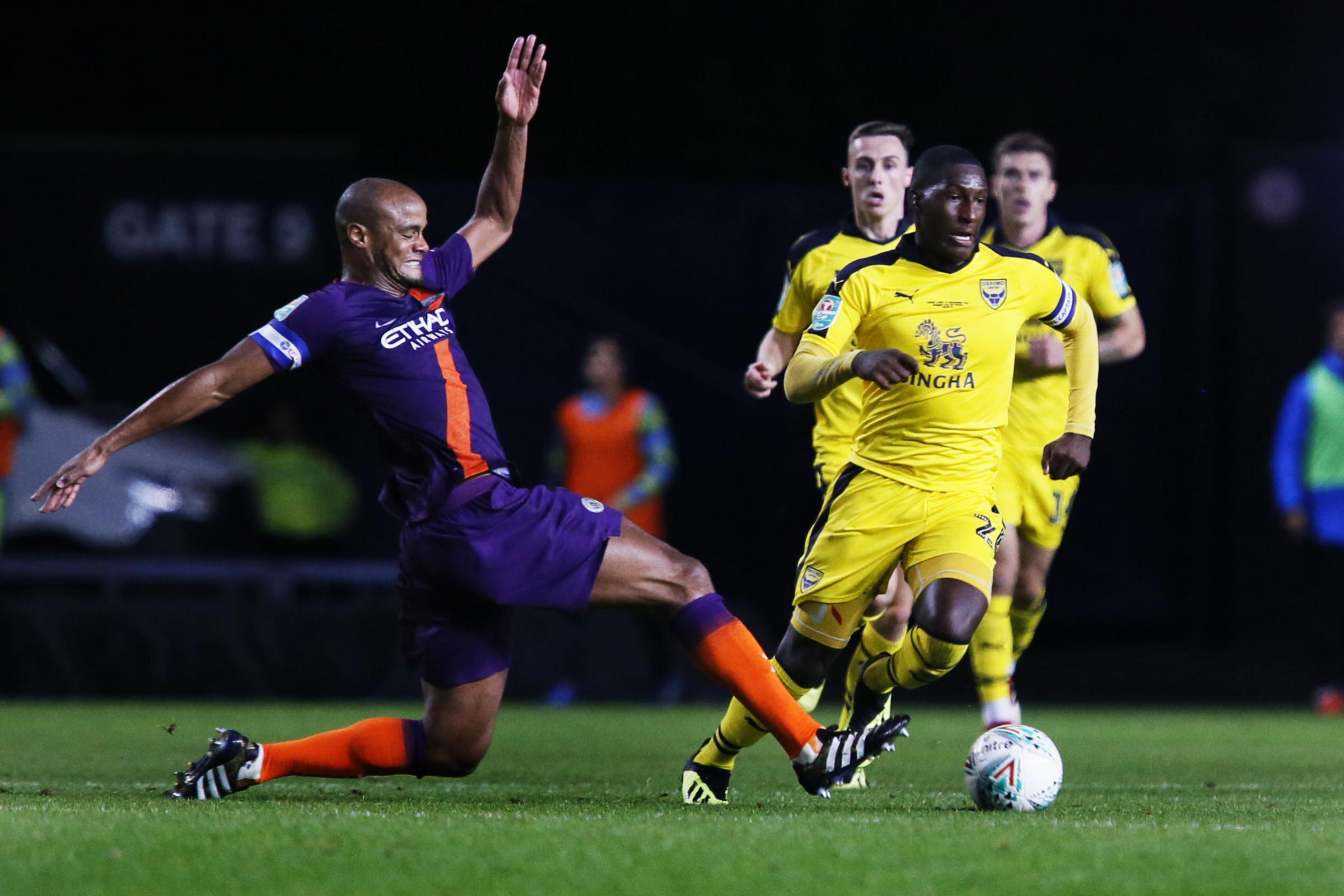 BIG MOMENT: Oxford United captain Shandon Baptiste tackles his opposite number Vincent Kompany during the Carabao Cup defeat against Manchester City on Tuesday