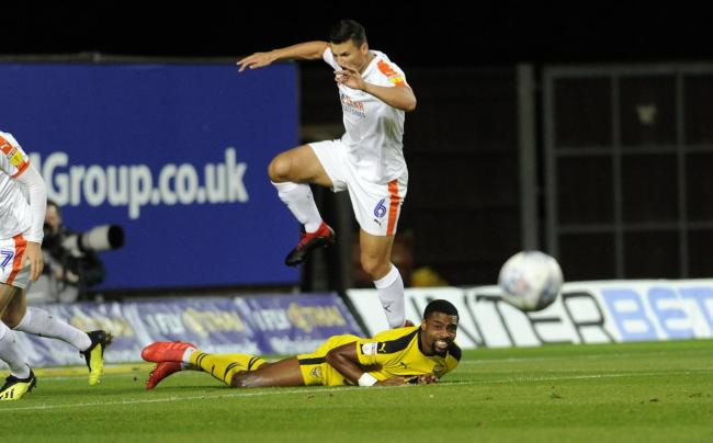 Oxford United's Jon Obika is flattened by a challenge from Luton Town defender Matty Pearson  Picture: David Fleming