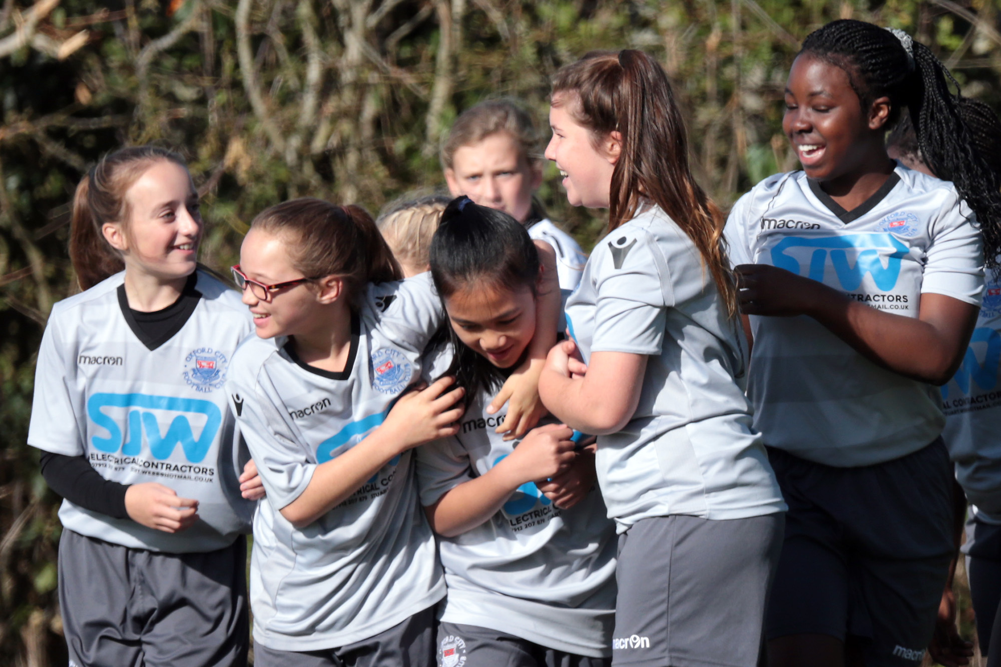 ON TARGET: Zoe Lemoncito (centre) is mobbed by her teammates after equalising for Oxford City during their Under 13 clash with Harwell & Hendred. City went on to win the game 2-1Picture: Ric Mellis
