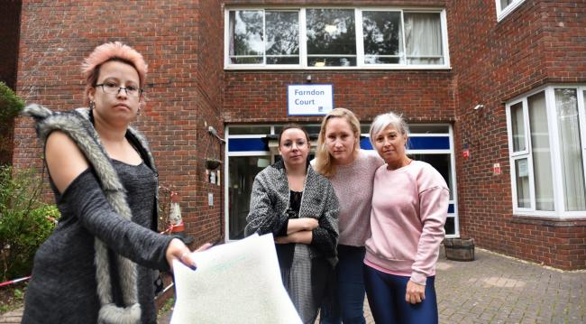 Seraphina Lorell and Silvia Pinna with other members of the Residents committee with eviction notice. Picture by Richard Cave