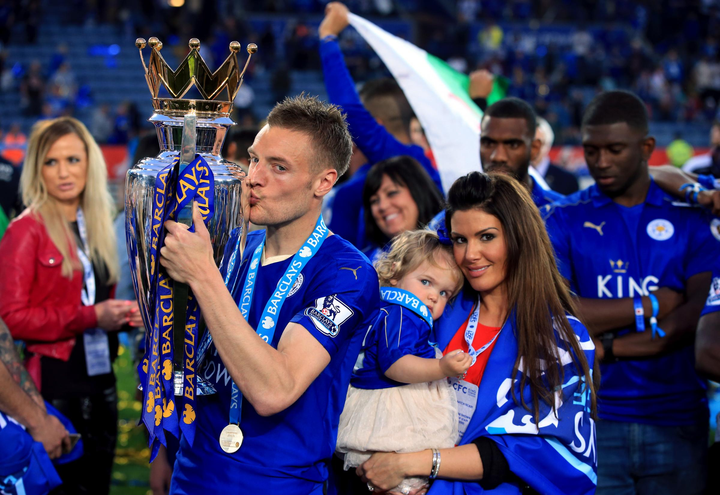 Leicester City's Jamie Vardy and partner Becky Nicholson with the trophy as the team celebrate winning the Barclays Premier League, after the match at the King Power Stadium, Leicester..