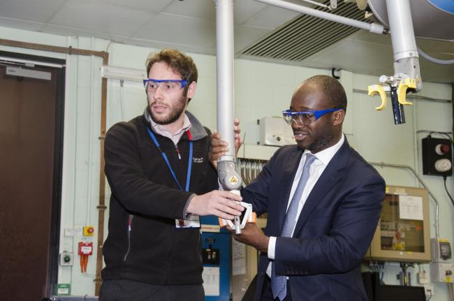 Sam Gyimah trying his hand on a remote-controlled robotic device at the European JET fusion experiment at Culham Science Centre