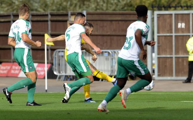 Jamie Mackie fires Oxford United in front against Plymouth Argyle  Picture: David Fleming