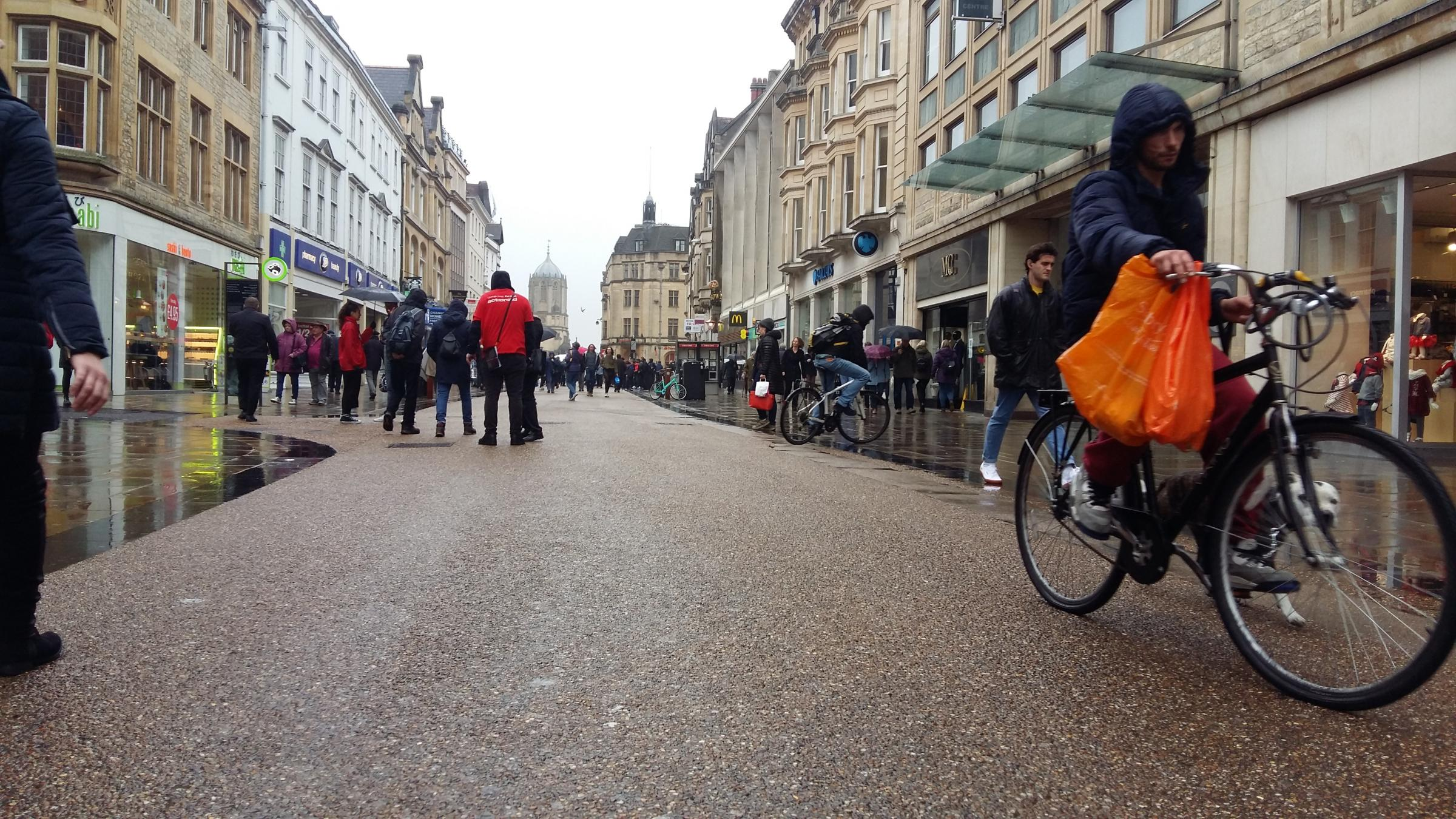 A cyclist in Cornmarket Street, which has seen a reduction in footfall. Pic Andy Ffrench