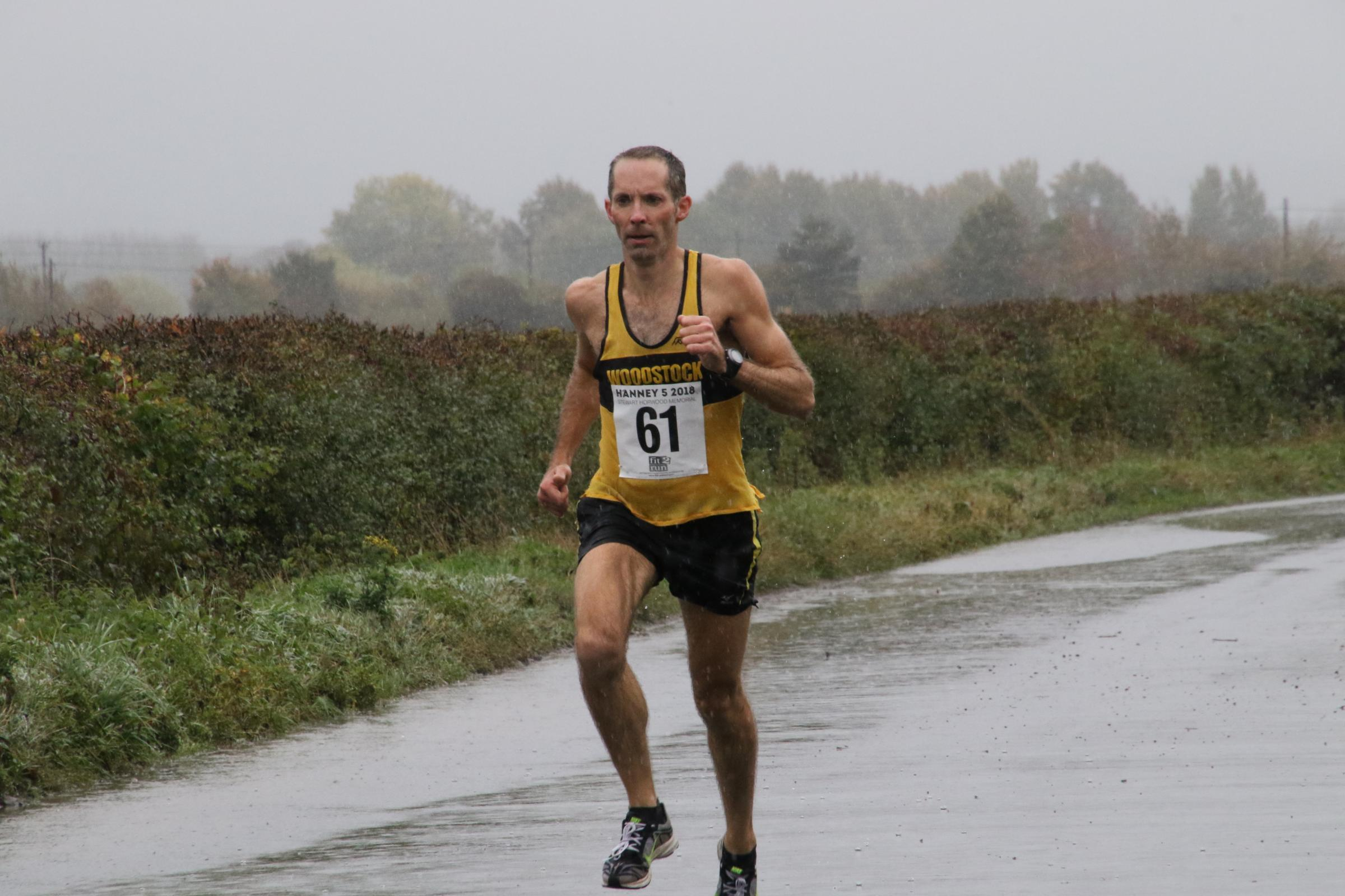 A drenched James Bolton on his way to victory at the Hanney 5 Picture: Barry Cornelius