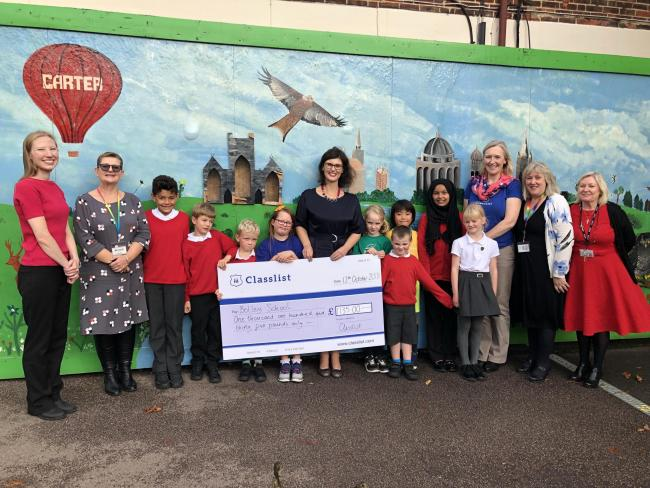 Botley School governor and MP Layla Moran, Alison Marsh, headteacher , PTA Secretary Kate Randall accepting the Classlist cheque