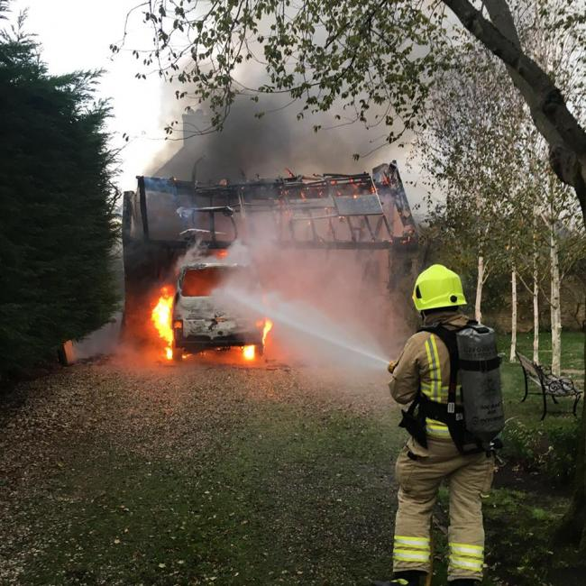 PICS: Firefighters tackle van blaze seen 'for two miles'