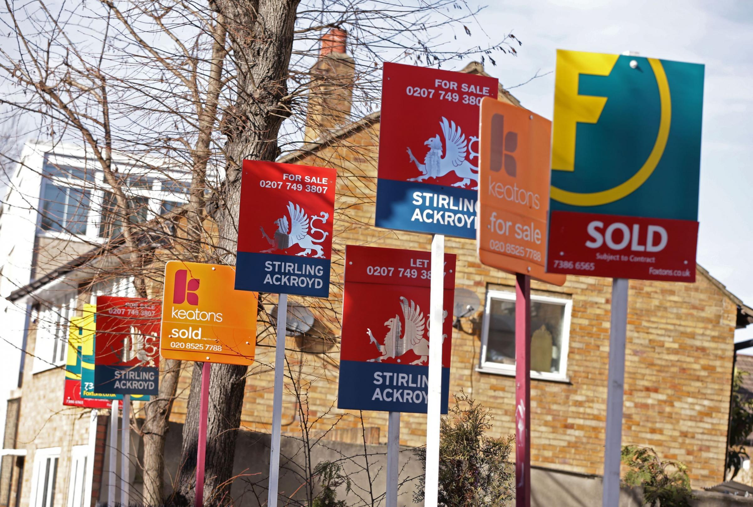 01/03/15 PA File Photo of Sold, For Sale and Let By signs displayed outside houses. See PA Feature HOMES Renovation. Picture credit should read: Yui Mok/PA Photos. WARNING: This picture must only be used to accompany PA Feature HOMES Renovation.