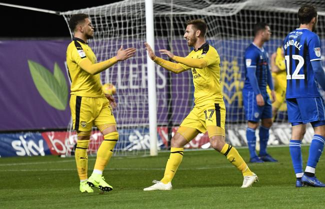 James Henry (right) celebrates his goal with Marcus Browne during Oxford United's 4-2 win over Rochdale Picture: David Fleming