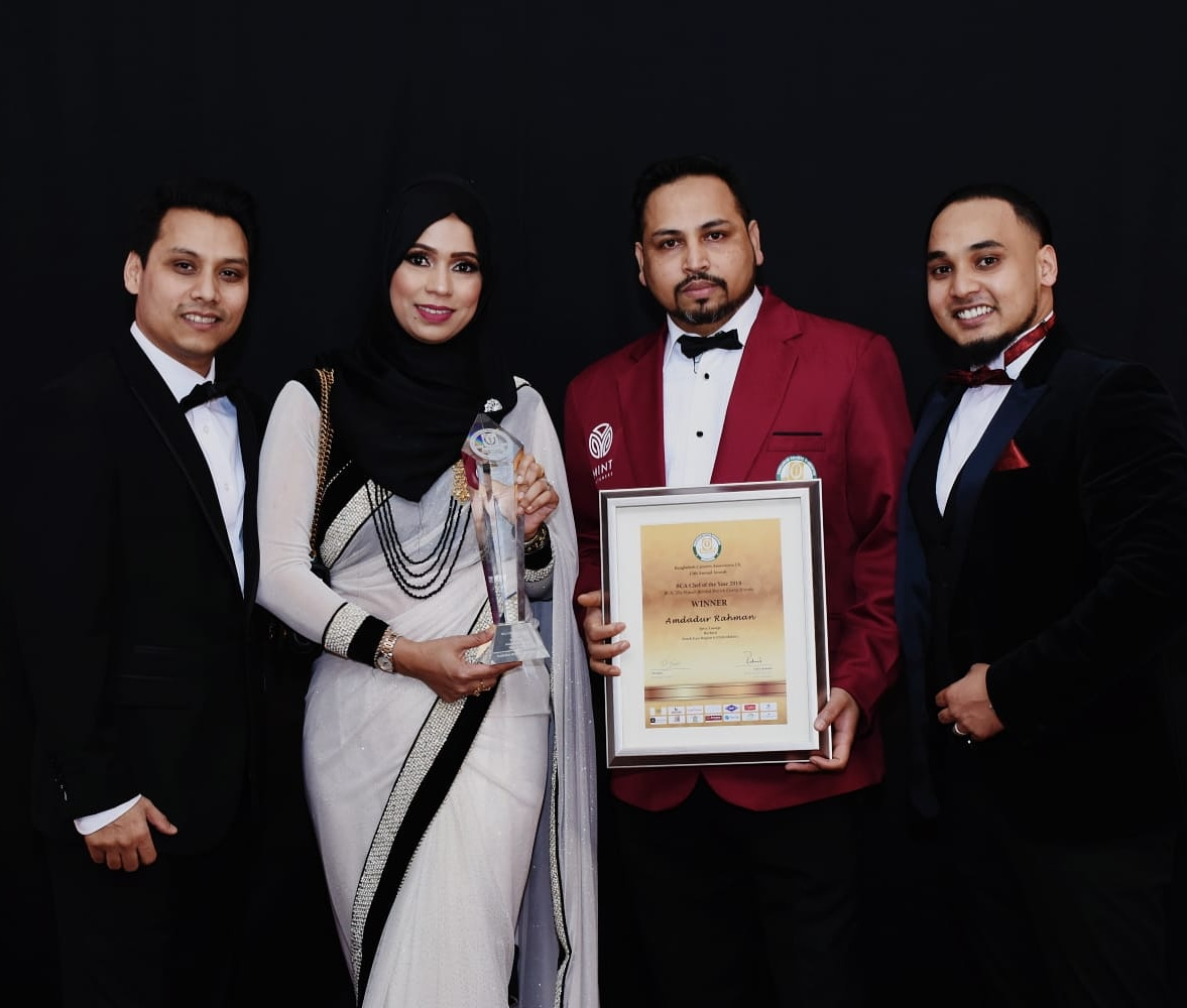 Staff from Burford's Spice Lounge celebrate the award Picture: Sam Al-Samad