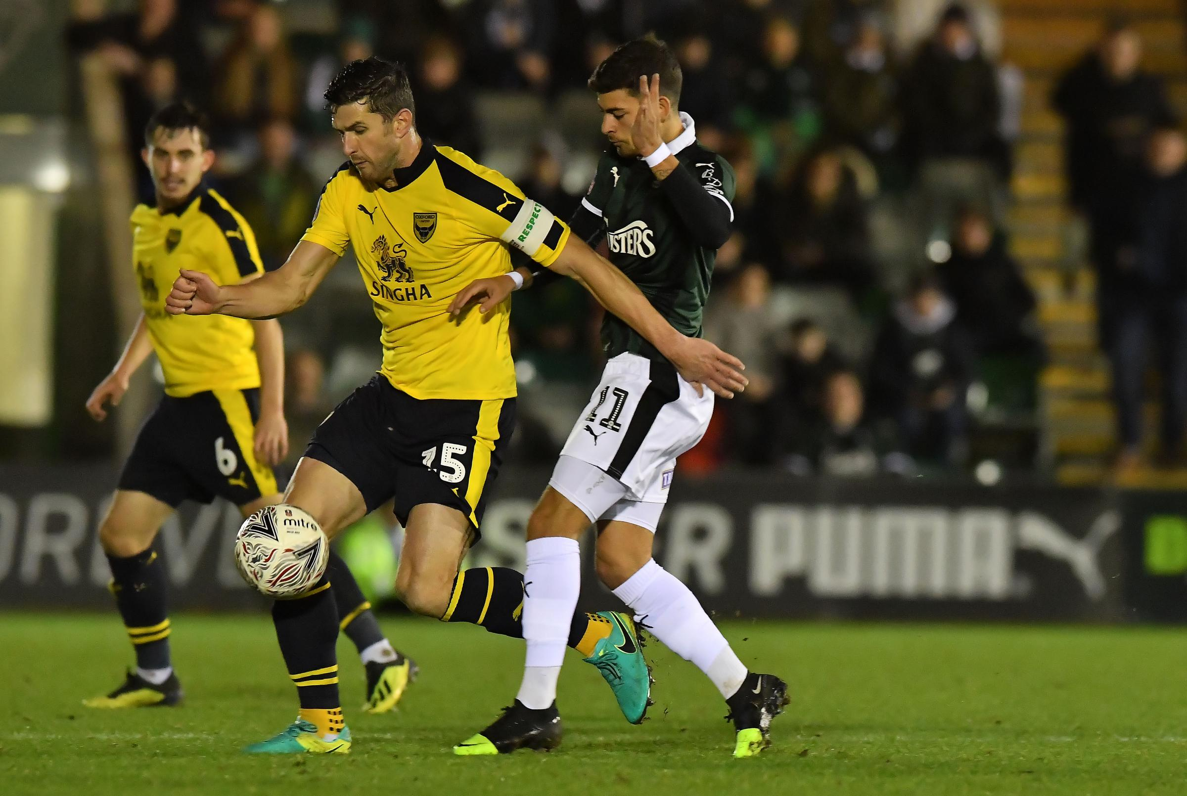 John Mousinho battles for the ball with Ruben Lameiras