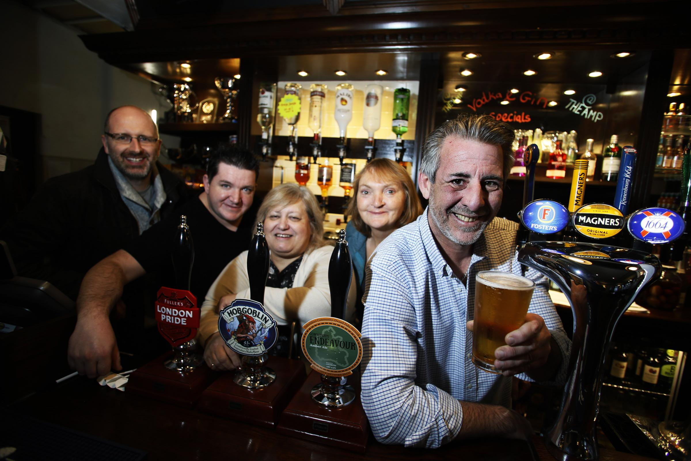 The Ampleforth Arms community pub in Risinghurst is celebrating a year since opening. L-R: Robert Cockerell, David Kavanagh, Lyn Simms, Tacye Sharp and Chris Kaymak