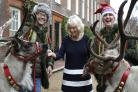 Duchess of Cornwall puts on festive fun day for Helen & Doulgas House children